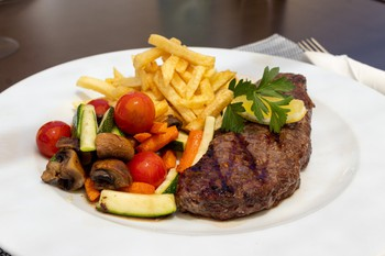 Beef Steak served with Chips and Sauteed seasonal Vegetables
