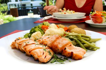 Grilled Salmon served with Roasted Potatoes and Sautéed seasonal Vegetables